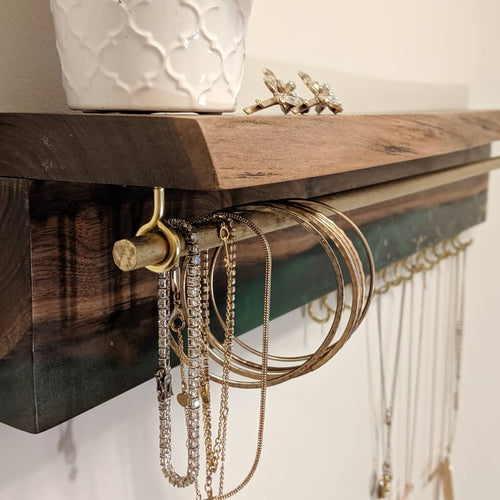 live edge walnut jewelry organizer with emerald epoxy and gold flecks