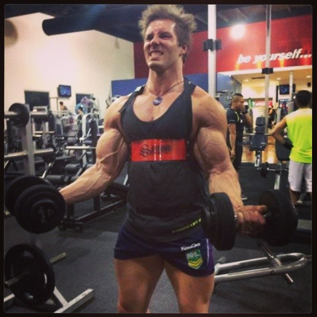 Aaron Curtis training with the red Strong Lift Wear Arm Blaster!