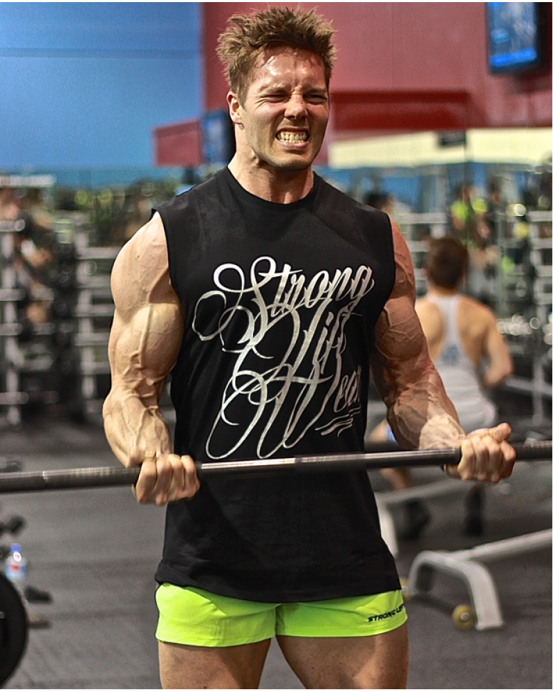 Aaron Curtis training biceps in the black Sleeveless Tee