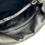 Unique shoulder bag with detachable strap. Made in Italy with soft embossed Cavallino leather.
