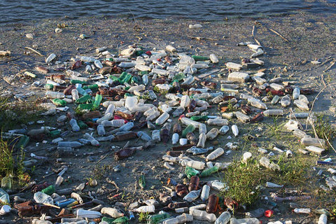 image of a bunch of plastic bottles sitting in landfill