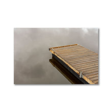 Load image into Gallery viewer, Wood dock on very still reflective water.  Clouds can be seen in cloud reflections.  Framed Art Prints - ZNA Creative