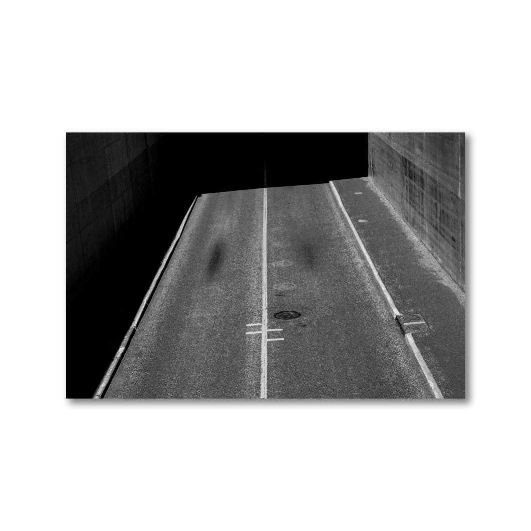 Black and white image of a road from above with dark contrasting shadow.  Framed black and white art prints 12x18 - ZNA Creative