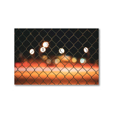 Load image into Gallery viewer, Warm tones of orange, red and yellow are wiped across the print in this framed long exposure photography print.  Highway 417's bokeh is pictured through a blurred chain link fence