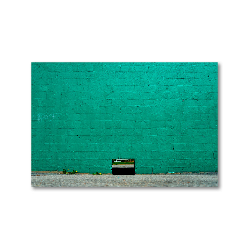 Large teal cement brick wall with small opening leading to soccer sports field.  Framed Art Prints - ZNA Creative