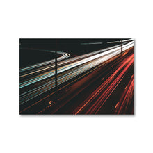 Load image into Gallery viewer, White and red light trails span across the 417 highway in Ottawa, Canada.  This long exposure photograph is shown printed 12x18 inches, with a black alder frame.  Original artwork from ZNA Creative, Framed Prints perfect for any home or office decor