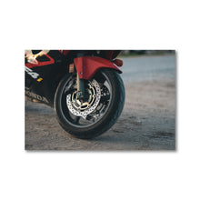 Load image into Gallery viewer, A framed photography print, perfect for any home, office, or garage. A Honda motorcycle tire is pictured, the red paint pops against the contrasted gravel parking lot ground. Framed giclee art prints.