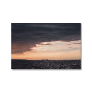 The Nottawasaga Lighthouse on Georgian Bay, as seen from Sunset Point Park in Collingwood, Ontario.  Cloudy skies cast against dark water make this lighthouse stand out against the storm