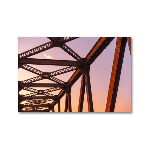 Rusty red and orange train bridge trusses with strong pink and orange gradient appearance sunset.  Framed sunset truss art prints 12x18 - ZNA Creative