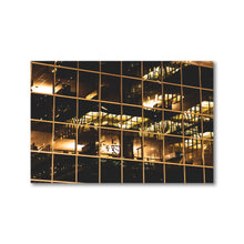 Load image into Gallery viewer, Golden reflections of lights and office building glass at night in Ottawa, Canada.  Framed Prints | ZNA Creative