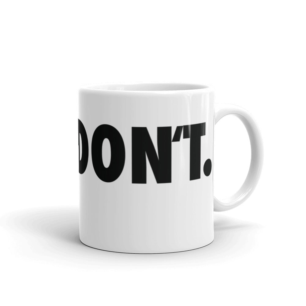 White coffee mug with black text reading