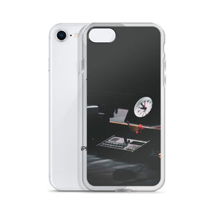 An iPhone case picturing a radio control station, with a clock, phone and some recording equipment.  Dark, sleek iPhone cases with custom photography