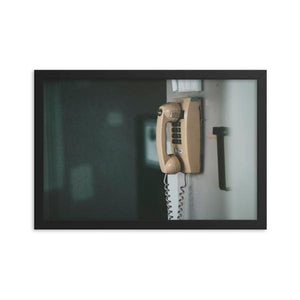 An abandoned telephone sits on a drab wall.  This framed photography poster can make a dramatic addition to any home or office. The telephone pictures sits atop a ski hill in Ontario