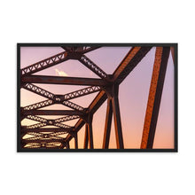 Load image into Gallery viewer, Rusty red and orange train bridge trusses with strong pink and orange gradient appearance sunset.  Framed sunset truss art prints 12x18 - ZNA Creative