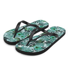 Load image into Gallery viewer, Love floral print?  Us too!  Our fresh and trendy floral print flip flops are sure to up your game at the beach or pool.  The black Y strap keeps the sandals on your feet, while providing a strong and tasteful contrast against the green and white floral print of the flip flop.  Get beach ready!