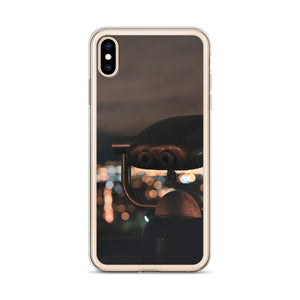 A public set of pay-per-use binoculars sit atop Mont Real Park in Montreal, Quebec, overlooking the bokeh and blurry city lights in the background.  This Montreal iPhone case is a great representation of the city at night.  In this image the case is pictures on the iPhone