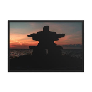 Large inukshuk  monument silhouette set against deep sunset background.  Framed sunset art prints 12x18 - ZNA Creative