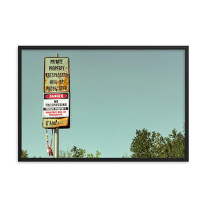 Old retro feeling rusty and beat up no trespassing sign with muted sky.  Framed art prints 12x18 - ZNA Creative