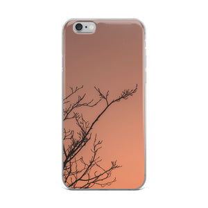 Tree branches cast against a dramatic orange sunset sky.  This popular iPhone case is perfect for anyone with an appreciation of nature and sunsets.  Camping, hunting, and fishing iPhone cases for outdoors