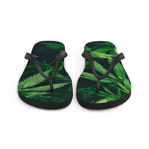 Cannabis themed flip flops, with large weed fan leaves across the soles.  A black Y strap keeps the sandals fitting snugly, while keeping you looking fresh with these celebratory legalization flip flops on your feet.