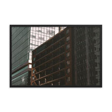 Load image into Gallery viewer, A 12x18 framed print of a bright building casting a shadow upon an apartment building beneath it.  This moody photograph was taken downtown Ottawa, Canada.  The shadowed apartment has an 80s feel, with red brick and concrete balconies; while the bright tower next to it is modern, with light blue curtain wall glass.  Framed Office Art Prints.  ZNA Creative