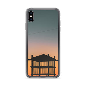 Creative iPhone case with wooden beach tower silhouette cast against a beautiful sunset
