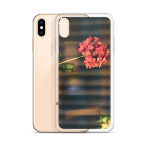 Creative iPhone case with beautiful red/rose flower, as seen through the slight bokeh blur of the horizontal window shadesCreative iPhone case with beautiful red/rose flower, as seen through the slight bokeh blur of the horizontal window shades