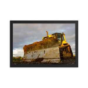 Dirty yellow bull dozer tractor with deep cloudy sky in background.  Farm and construction art.  Framed Art Prints - ZNA Creative