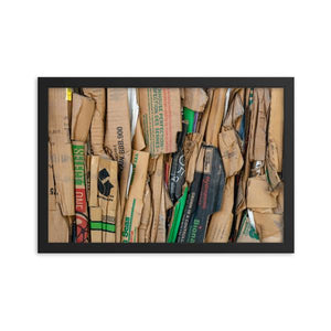 Side view of a bundle of compressed brown cardboard boxes.  Framed Art Prints - ZNA Creative