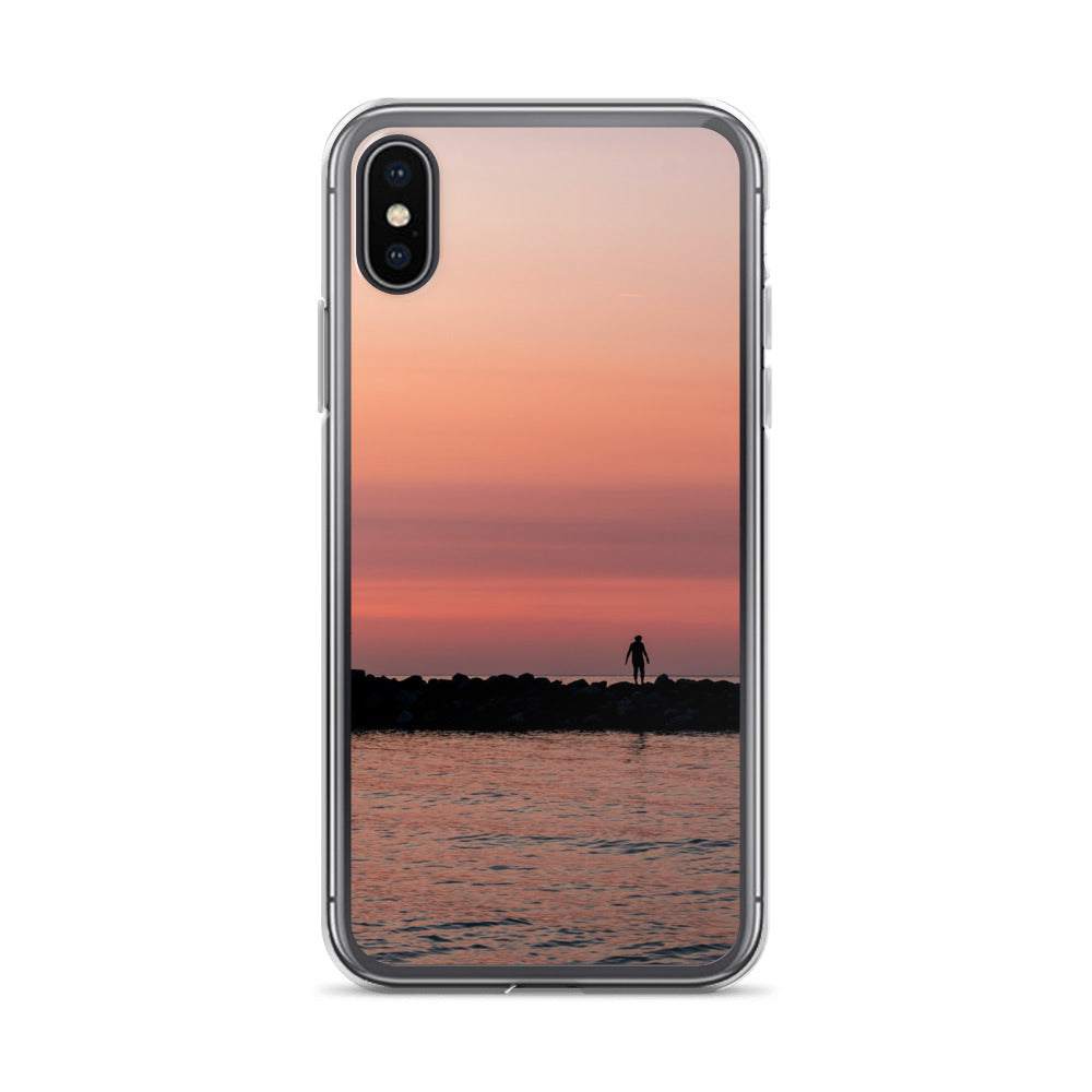 The Silhouette of a single person standing along the water breakwall can be seen in this dramatic and popular sunset iPhone case.  The case is quite durable and the deep hues of the sunset make it a must have for any iPhone case collector
