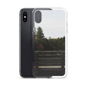 An iPhone case with a photograph of a wooden bridge in the Fall or Autumn.  Various evergreen and fall trees can be seen in the background of this moody picture taken in Gatineau Park, Gatineau, Quebec, Canada.  Gatineau Park Ottawa Souvenirs.  iPhone X Cases