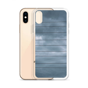 Creative iPhone case with dark power lines and telephone lines, cast against a moody and dramatic background of storm clouds on a warm summer evening