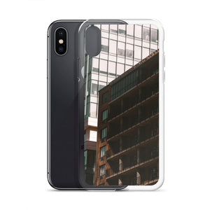 Tall buildings can be seen on this popular iPhone case.  A smaller apartment building is cast into shadows by it's taller neighbours.  City and urban theme iPhone cases