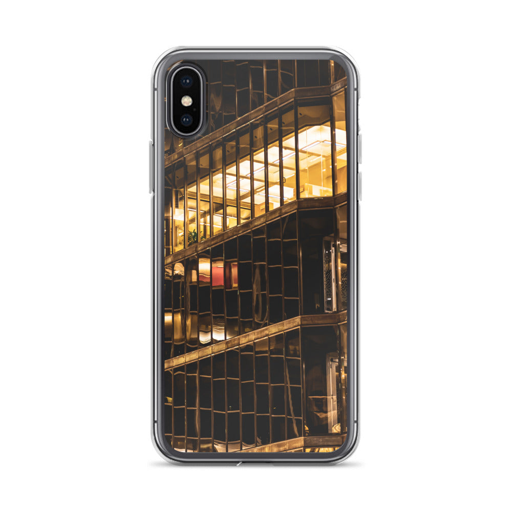 Moody yellow fluorescent lighting can be seen through the glass windows of this downtown skyscraper at night.  This urban iPhone case is perfect for anyone with a love of their city.  Trending iPhone cases