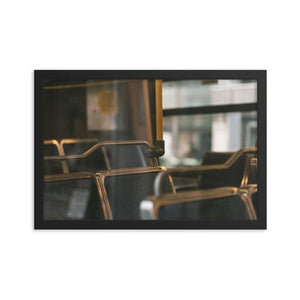 A photograph of empty seats on an OC Transpo bus in Ottawa, Canada.  The blue, ridged fabric on the seats can be seen through the tasteful reflection of the outer bus window.  Framed Print shown with a black alder frame, in the size of 12x18 inches.