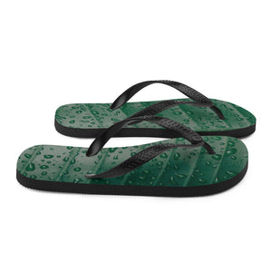 Beautiful and calming water droplets pictured across a green, forest leaf.  The black Y strap contrasts against the green leaf flip flop print perfectly.  Express yourself!