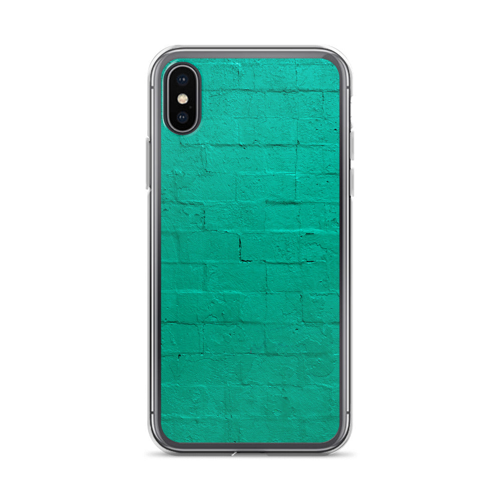 A cement block wall, painted with vibrant teal paint is pictured on this durable, stylish iPhone case.  Popular teal iPhone cases
