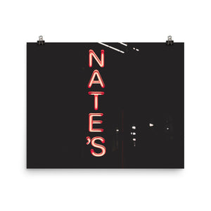 "A poster of a red neon sign depicting a local restaurant's name, ""Nate's"".  The poster is quite dark, creating a dramatic appearance for the bright, neon sign.  Sparks Street, Ottawa, Canada"