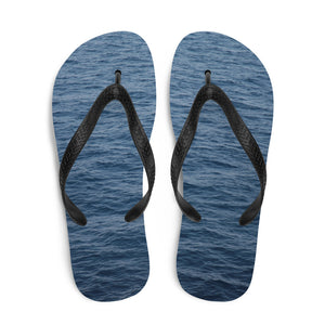 Creative flip flops with a ripple water print on the soles.  These dark blue flip flops fade to a gradually lighter blue.  The black Y strap and black edges on the sole ensure a fresh look no matter where you're walking, relaxing or swimming.  Get beach ready.