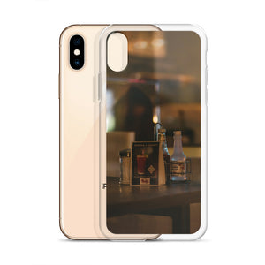 Late night condiments, ketchup, vinegar, salt and pepper, are pictured through a glass window with a dramatic reflection on this popular iPhone case