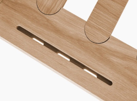Close up of Eva timber bed base device holder