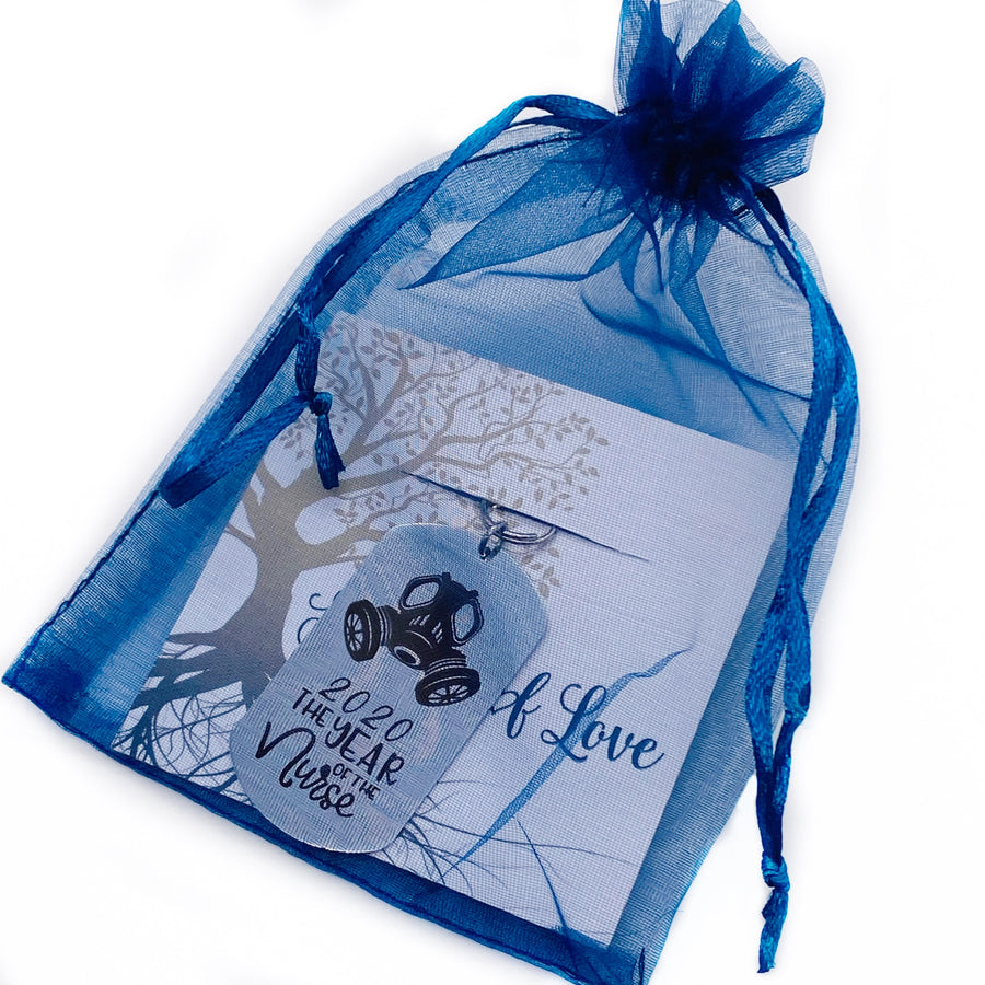 dog tag packaged in a blue organza gift bag