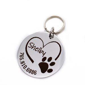 Silver stainless steel dog collar id tag with black engraving with a picture of an open heart paw print, pets name and telephone number