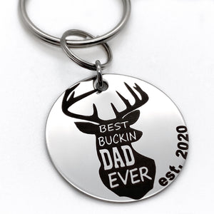 "1.25 inch shiny stainless steel disc engraved with a buck deer head shiloutte and teh verbaige ""best bucking dad ever"" engraved with ""est 2020"""