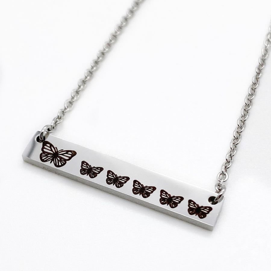 mother's butterfly bar necklace with baby butterflies