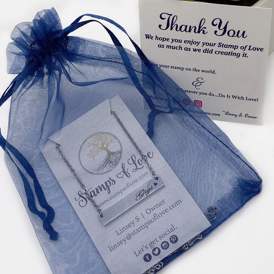 packaged blue organza gift bag
