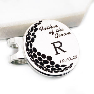 "1 inch golf marker with hat clip engraved with ""Father of the Groom"" initial ""R"" and the date ""10.10.20"""