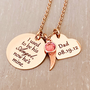 "rose gold stainless steel 7/8"" round disc engraved with ""I used to be his Angel, now he's mine"", an angel wing charm, a October pink  birthstone, a 3/4"" engraved heart with ""Dad 08.19.12"". all charms are attached to a rose gold stainless steel cable chain."