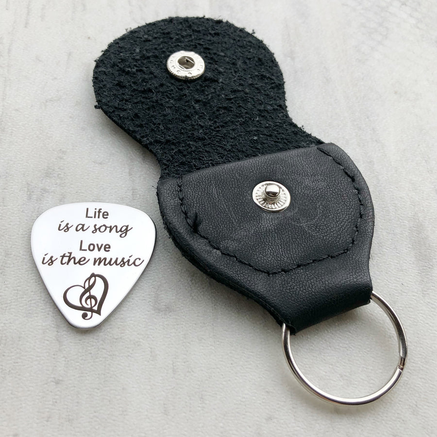 guitar pick with black leather keychain case