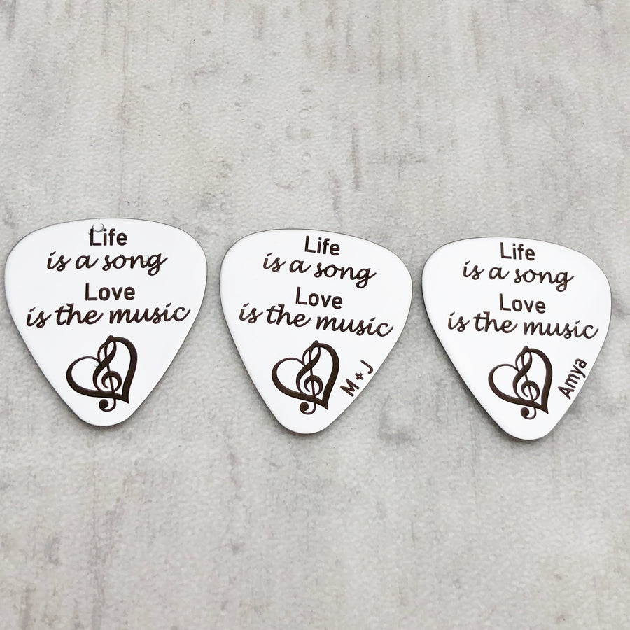 """Life is a song. Love is the music"" silver stainless steel guitar pick personalized with initials, name , and date"